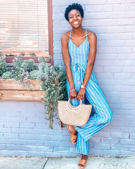 My Favorite Blue Striped Jumpsuit | stripes | jumpsuit | Romper | backless | tie | summer looks | summer outfit | beach | rattan bag | rattan purse | flats | wedges http://liketk.it/2RbhZ #liketkit @liketoknow.it #LTKspring #LTKunder50 #LTKitbag