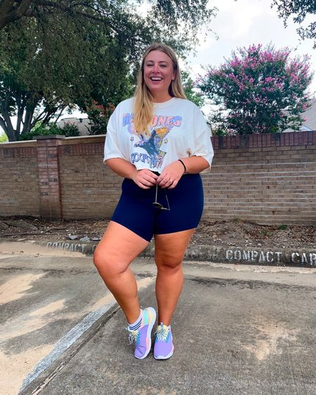Casual biker shorts outfit styled with crop top and colorful sneakers   #LTKcurves #LTKstyletip