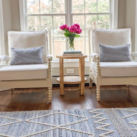 Out of any pieces in my home, I get the most questions on my living room rug and spindle chairs! The rug quality couldn't be better and it adds such great texture to our living room! It also comes in a beautiful natural and cream color, and lots of sizes, including a runner! I selected the Bevin Natural fabric for our chairs. Also, these lumbar pillow covers are normally $15.99 for TWO!  @liketoknow.it @liketoknow.it.home #liketkit #LTKfamily #LTKhome #LTKstyletip http://liketk.it/3jsJ7  summer decor, summer home decor, summer home decoration living room, summer home, coastal decor, beach house decor, beach decor, beach style, coastal home, coastal home decor, coastal interiors, coastal decorating, coastal house decor, blue and white home, blue and white decor, coastal living room, coastal family room, coastal sunroom, serena & lily,  serena and lily textured rug, textured runner, 5x7 rugs, 6x9 rugs, 8x10 rugs, 9x12 rugs, 11x14 rugs, 12x18 rugs, blue and white rug, serena & lily rugs, ryder rug, ryder denim rug, ryder denim, spindle chair, arm chair, side chair, living room decor, living room rugs, large living room rug, living room ideas, neutral living room, neutral living room rug, neutral living rooms, neutral living room chairs, coastal farmhouse decor, neutral home decor, cane, seagrass, rattan, side tables, wicker tables, living room side tables, bedroom tables side, bedroom side tables, hallway table, lumbar pillows, lumbar throw pillow, lumbar pillows for chair, lumbar pillows for bedroom, pillows with poms, pillows with pom poms, navy and white pillows, striped pillows, striped pillow covers, amazon pillow covers, amazon pillows, coffee table books, coastal coffee table books, home decor on sale, target home, target furniture, target side table, affordable side table, coastal side table