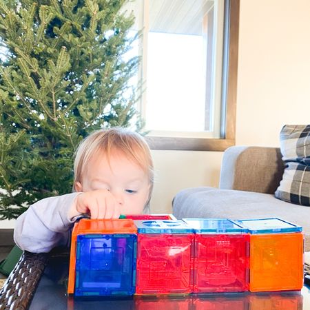In the name of encouraging shopping with intention, If there was only ONE toy we would recommend, this would be it. It's so versatile, our girls use this toy in play all throughout our home. And they're not just for building!  Ways we use tiles: shape recognition + creation tracing counting color recognition primary/secondary colors color grouping (warm/cool) color blending (yellow + blue = green) kitchen play (plates and food items) roadway and path creation dominoes on the go toys for road trips!  If you're family has these, what are ways you play? I have them linked on the blog! Just find this photo to shop. If you do purchase through my link, I receive a small affiliate commission, and I want to thank you for supporting @houseofeilers, it means a lot to me! 🤎  Here's our two year old building a series of rooms for small trinkets, prompted by no one.🤩 #unfilteredswipe for yesterday's dominoes fest with the big girls.   Follow me on the LIKEtoKNOW.it shopping app to get the product details for this look and others @liketoknow.it.family @liketoknow.it.home @liketoknow.it #LTKbaby #LTKkids #LTKfamily #liketkit http://liketk.it/32m5H