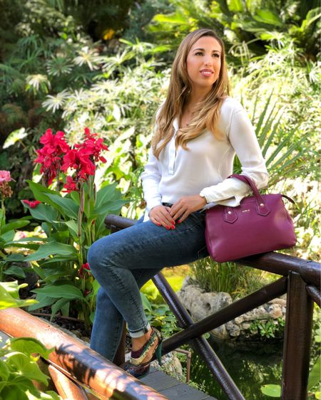 This burgundy Furla bag from Saks Fifth Avenue is amazing! My trendy high heels are from Aldo Shoes and my ultra comfy skinny jeans are from American Eagle Outfitters. I always get my jeans from them and from Guess.  This sweet white long sleeve blouse is from Mango.  Enjoy the end of th Summer! .....  Follow me on the LIKEtoKNOW.it shopping app to get the product details for this look and others http://liketk.it/2WZeh   @liketoknow.it @liketoknow.it.europe  .....  #liketkit #LTKeurope #LTKitbag #LTKshoecrush