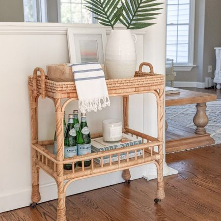 My South Seas Side Cart is easily one of my most versatile pieces of furniture in my home. I've used it in my kitchen, bathroom, and guest room! @liketoknow.it @liketoknow.it.home #liketkit #LTKhome #LTKunder50 #LTKstyletip http://liketk.it/3jsEr  coastal decor, beach house decor, beach decor, beach style, coastal home, coastal home decor, coastal modern, coastal interiors, coastal decorating, coastal house decor, coastal farmhouse decor, neutral home decor, coastal living room, neutral living room, living room decor, coastal kitchen, coastal kitchen decor, blue and white home, blue and white decor, cane, seagrass, rattan, coastal modern living room, rattan table, sunroom decor, decor for sunroom, furniture for sunroom, sunroom furniture, bar cart decor, bar cart styling, coastal bar cart, bar cart decorations, turkish towels, turkish hand towels, turkish kitchen towel, turkish towel bathroom, turkish tea towel, turkish towel bath, hand towels bathroom, hand towels kitchen, hand towels white, hand towels for bathroom, hand towel with fringe, striped towels kitchen, white pitcher, white vase large, white vase tall, white vases decorative, white vase with palms, palm leaf, palm leaves, palm leaf stems, palm stems, stems in vase, stems home decor, coffee table decor, decorative bowls wood, decorative bowl decor, decorative bowl coffee table, decorative bowl entryway, decorative bowl dining table, decorative bowl centerpiece, beach print, white frame, white picture frame, serena and lily, serena & lily, west elm, Target home, Target finds, Target decor, Target home decor, Amazon home
