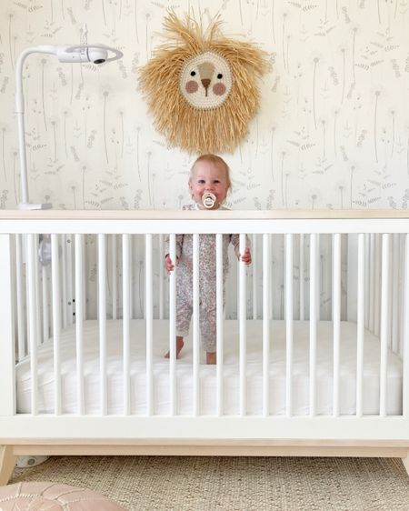 she's dainty and sweet like the wildflower wallpaper but can be fierce like the lion on the wall! you should hear the roars that come from her room when she's ready to get out of her crib in the morning! 🤍🦁 #liketkit @liketoknow.it http://liketk.it/3fxdj #LTKkids #LTKhome #LTKbaby