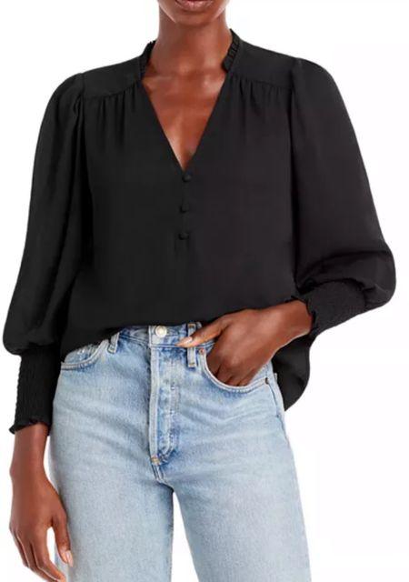 Black smocked puff sleeve blouse   #LTKSeasonal #LTKunder100 #LTKworkwear