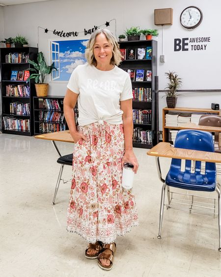 Casual everyday fall teacher outfit featuring a REQD graphic tee and ruffled tiered floral boho midi maxi skirt and Birkenstocks #floralskirt #boho #tieredskirt #maxiskirt #midiskirt #floral #read #reading #booklover #teacher #mom #skirt #Petite #midsize #Casual http://liketk.it/3m5Bv @liketoknow.it #liketkit