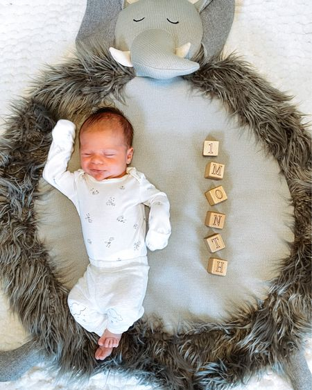 One month of Christian 💙  You are the sleepiest boy we know with a raspy little cry & are already super strong! You make us oh so tired and happy all at once. We can't wait to see more of your silly faces & that smile you sometimes flash us!  Linking similar baby play mats in our baby boy nursery. Screenshot any of my pics to shop in the @liketoknow.it app & give me a follow! http://liketk.it/3btLJ #liketkit @liketoknow.it.family #LTKbaby #LTKfamily #LTKunder100