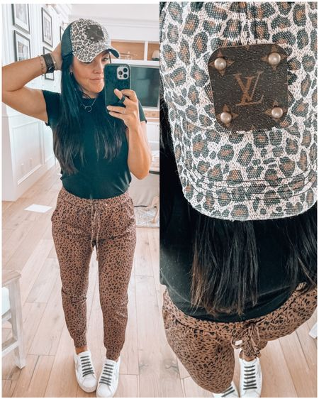 authentic upcycled Louis Vuitton hat on sale $35 use code MYSHA10 for extra 10% off sitewide! The leather bracelet band is on sale too!   Leopard joggers come in 3 colors & $25 free shipping. Wearing size small.    http://liketk.it/3eC2T #liketkit @liketoknow.it amazon finds amazon fashion #LTKunder50 #LTKsalealert