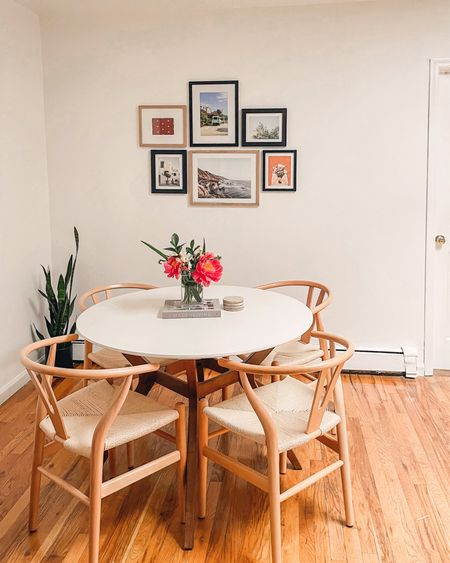 NYC apartment dining nook! Made a lot of progress but still need a rug and maybe a plug in pendant above? Love This table and chairs combo! Plus the chairs are on sale right now!!!    #LTKhome #LTKsalealert