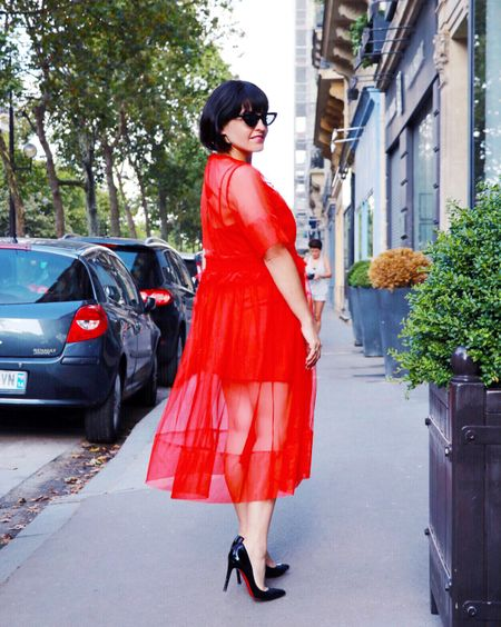 Do you ever make bold fashion choices, or do you tend to play it safe? _ One of the benefits of being in Paris for Haute Couture Fashion Week was getting to stretch my outfit choices and try some forward thinking looks (like this sheer, red ruched dress that was layered over a slip dress). All I needed with it was a pop of red from these classic Louboutins. I loved standing out, though I know it can be intimidating. _ Would you wear something like this? If so, shop it on @liketoknow.it on the app or directly on #liketkit here: http://liketk.it/2wG5n (its under $50!! Can't say the same about the shoes tho 😝) _  #LTKunder50 #LTKshoecrush #LTKstyletip