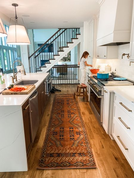 I love doing big reveals with our house projects, but with construction delays and the general busyness of life, I don't want to wait until it's perfect. These every day scenes are better than any official reveal. Pajamas and all. #dontwait    #kitchen #whitekitchen #dreamhome #rug #runner #kids #home #rejuvenation #momogram #appliances #topknobs #gold #goldfixtures   #LTKfamily #LTKhome #LTKkids