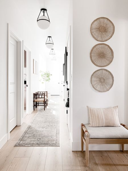 I always forget to link these modern versatile ceiling lights here. I love that they have a pendant light vibe with but are ridgid light fixtures. Those globes are bigger than they look too! The wall art is actually placemats! Sources on my insta! 😘 http://liketk.it/3a9rT #liketkit @liketoknow.it