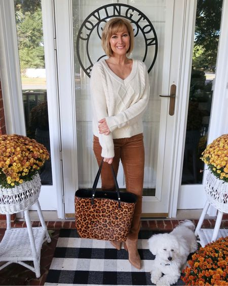 My kids sweater is the perfect fit. Wearing the 15/16. It's also only $39.50 and on sale buy one get one 50% off. These brown cords are stretchy and come in many colors. Carrying this really nice quality leopard tote.   #LTKsalealert #LTKSeasonal #LTKunder50