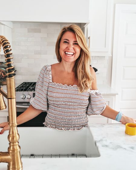 All here for smocked tops and a great Amazon find, like this kitchen corn stripper. Y'all, this think makes cutting corn off the cob a breeze! Smocked top with drape sleeves is from @loft ! @amazon    Shop my daily looks by following me on the @liketoknow.it shopping app http://liketk.it/3jUuz    #liketkit #LTKhome #LTKsalealert #LTKcurves #kitchen #kitchentools #amazon #amazonfinds #smocked #smockedtop #loft #drapesleeves