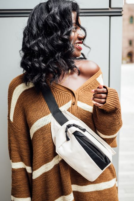 Gift for her! Black and white Fanny pack, also can be used as a crossbody. Brown and white sweater dress. Im wear a 1x for very slouchy oversized look.   #LTKunder50 #LTKHoliday #LTKGiftGuide