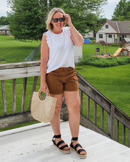 Casual everyday summer Walmart outfit featuring a sleeveless crochet top, utility shorts, a straw bag, woven slides, and RayBans #teacger #summer #walmart #walmartfashion #affordable #casual #shorts #croxhet #whitetee #tanktop #utilityshorts #espadrilles #rayban #strawbag #petite http://liketk.it/3gHfn @liketoknow.it #liketkit