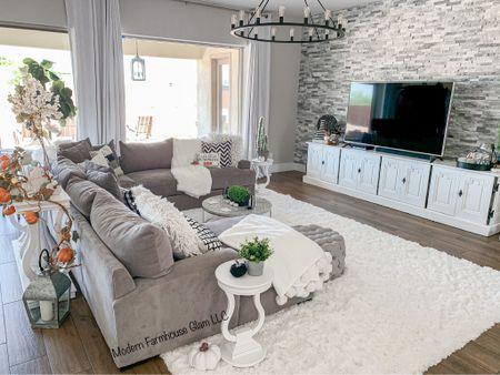 Living room furniture at ModernFarmhouseGlam  Couch sofa sectional wagon wheel light shag white rug home decor  #LTKhome #LTKSale #LTKSeasonal