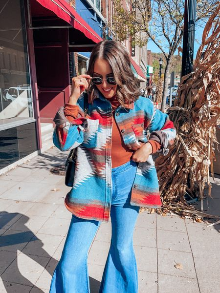 70s inspired fall outfit featuring Aztec design shacket, rust turtleneck, flare jeans - s in tops, 26S in flares, size up .5 in booties!     #LTKunder100 #LTKSeasonal