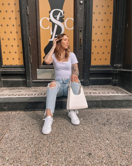 White bodysuit paired with distressed ripped light blue mom jeans and white sneakers. Perfect outfit for spring and summer! Bodysuit is a medium. Jeans are a size 4. http://liketk.it/39WbC #liketkit @liketoknow.it #LTKunder100 #LTKstyletip #LTKunder50