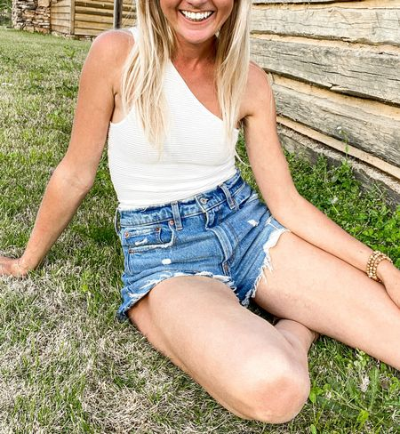 sale Summer date outfit  Abercrombie High Rise Mom Shorts and ribbed one shoulder white top as part of the LTK  Day Sale. These are my favorite denim shorts! Love the distressed look for date night, 4th of July, outdoor party.   #LTKDay #LTKsalealert #LTKSeasonal