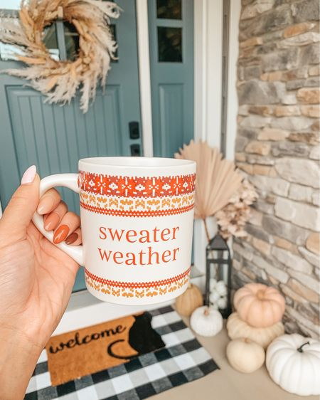 Sweater weather is here and so is $5 mug season 🍁☕️ Linking this mug and all our fall outdoor decor in the @shop.LTK app   Use code SARAH10 for 10% off the buffalo check layering doormat or anything in the @nickeldesign shop #sweaterweather #falldecor #fallporch #targetstyle #ltkhome #fallinspo #mug #autumndecor #fall #porchdecor #frontporch #pumpkins #fallnails  #mugs #homeblogger #curbappeal #frontdoordecor #whitepumpkins  #falldecorations #americandecor #doormat #welcomemat #bohemiandecor #blackcat #farmhousechic #boycottboringnails #halloweenhome #nailinspo #fauxpumpkins #halloweendecor