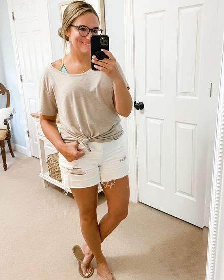 Oversized tshirt. Neutral top. White distressed denim shorts. Tkees neutral flip flop sandals. One piece swimsuit. @liketoknow.it http://liketk.it/3k1EI #liketkit