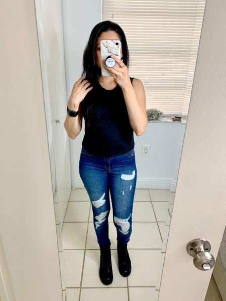 Crop top, ripped jeans, and combat boots look. These black boots are under $40 and it's also available in brown color. I also wear my Fitbit Versa watch to track my sleep and daily steps.  #LTKstyletip #LTKtravel #LTKunder50