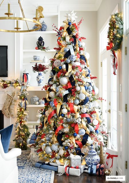 Gorgeous Christmas tree decor in blue read and gold! Layers and layers of beautiful ribbon and ornaments create beautiful fullness  #LTKstyletip #LTKHoliday #LTKhome