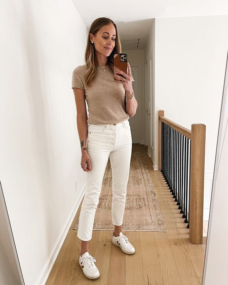 Love this cashmere short sleeve sweater from my capsule wardrobe. Wear now with white jeans and sneakers and transition into fall by layering under jackets. Runs small - I sized up to a small (fitted) go up 2 sized for more relaxed fit   #LTKunder50 #LTKstyletip #LTKunder100