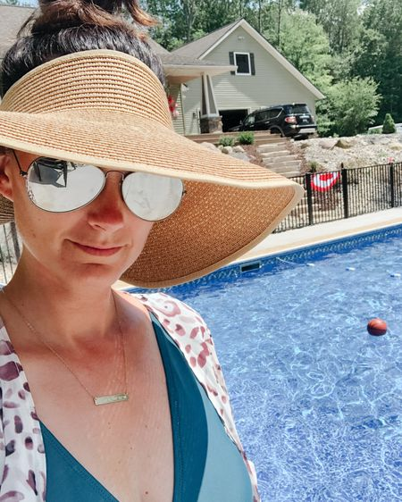 Pool mom! Doing my best to protect my face from the sun while still having the best time with my babes in the pool! I love this sun visor so much I ordered another one! Kimonos are my favorite kind of cover up too!   http://liketk.it/2Rrnq #liketkit @liketoknow.it