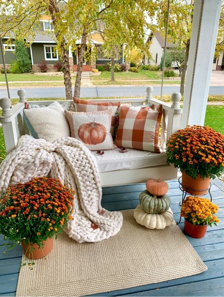 Cozy up to Fall on the porch means lots of pillows, throws, and pumpkins!   #LTKfamily #LTKSeasonal #LTKhome