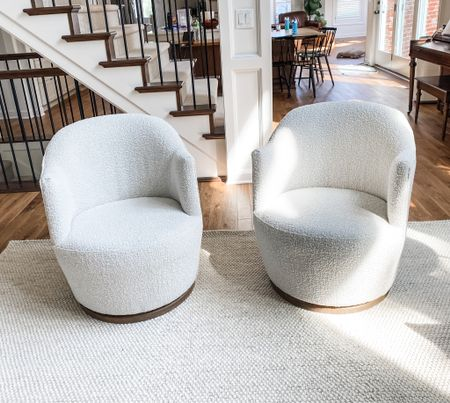 Once we got the swivel chairs we originally purchased into the living room, we realized right away they were too big. So we pulled the trigger on these boucle swivel chairs and I couldn't be happier! They fit perfectly into the space, are super comfortable, and don't have any loose cushions for the kids to mess with.   #chair #livingroom #swivelchair #boucle #neutral #neutrals #lightandbright #sidechair #livingroomfurniture #furniture #inspo #dreamhome #renovation   #LTKfamily #LTKhome #LTKsalealert