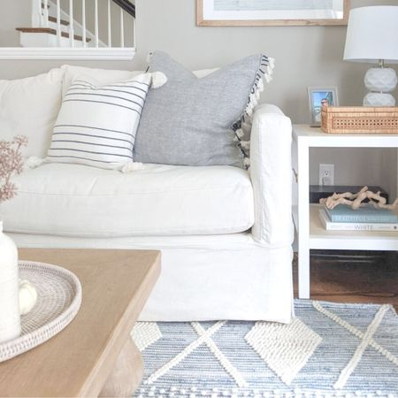 """Use code """"NEWSEASON"""" to take 20% off your entire order at Serena & Lily. Many of these pieces in our living room I've purchased during various Serena & Lily sales! - coastal decor, beach house decor, beach decor, beach style, coastal home, coastal home decor, coastal decorating, coastal interiors, coastal house decor, home accessories decor, coastal accessories, beach style, blue and white home, blue and white decor, neutral home decor, neutral home, natural home decor, serena and lily, serena & lily sale, serena & lily rugs, serena and lily rugs, living room rugs, bedroom rugs, coastal rugs, rectangle rugs, rectangular rugs, blue and white rugs, rugs with blue, 5x7 rugs, 6x9 rugs, 9x12 rugs, 8x10 rugs, 11x14 rugs, 4x6 rugs, living room rugs, bedroom rugs, large rugs, small rugs, textured rugs, beach house rugs, Coastal rugs, neutral runners, rugs on sale, home accessories decor, coastal accessories, coastal living room, coastal family room, living room decor, couch pillows, couch pillow covers, sofa pillow cover, blue and white pillows, blue & white pillows, 20x20 pillow covers, 20x20 pillow covers, 24x24 pillow covers, 24x24 pillow covers coastal art, coastal artwork, beach artwork, wall art large, wall decor living room, large artwork,, coffee table books blue, coffee table books coastal, blue and white coffee table books, decorative objects, driftwood, driftwood branch, driftwood decor, grapewood branch, grapevine, ryder rug, ryder denim rug, end tables, living room end tables, living room end table decor, living room side tables, living room side table decor, coastal end tables, coastal side tables, white living room side table, white side tables, white end tables, square side tables, square end tables, serena & lily side table, serena and lily side table, serena and lily living room, cabot side table, white couches living room, willow sofa, crate and barrel sofa, crate and barrel willow, slipcover sofa, slipcover couches, white slipcovered sofa,  rattan tray, """