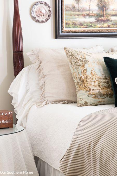 Ruffles, neutral and toile fabrics make up a gorgeous master bedroom for fall. Velvet pillows, toile pillows, ruffle shams, ticking stripe bedding   #LTKhome #LTKstyletip #LTKSeasonal