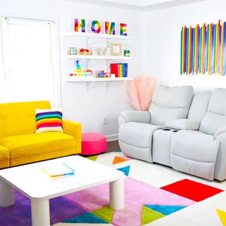 Rainbow Family Room🌈. . I mentioned yesterday in my post that I've basically turned our home into a #rainbowhouse ☺️ Well, here's another room to share that with you. After almost a year of us living in this house, I finally have the #familyroomdecor how I want it. What do you think?!?!. . Btw, I FINALLY have @liketoknow.it 🙌 so you can shop everything I have in this photo. http://liketk.it/3ald7 #liketkit #LTKhome #LTKfamily #LTKkids