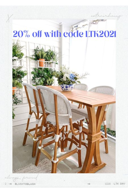 The best outdoor dining set ever is on sale this weekend only! White bar stools and high quality teak farmhouse table. Not to mention the pretty faux florals and greenery!  #LTKsalealert #LTKhome #LTKSeasonal