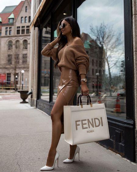 Fall outfit ideas  Revolve faux leather skirt Tularosa chunky knit sweater  Fendi sunshine tote  #LTKstyletip #LTKSeasonal #LTKunder100