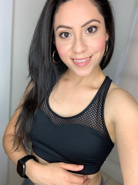 I like wearing sports bras that have a twist to them like this mesh pattern. Also wearing my Fitbit Versa to track my sleep and daily steps, mine is black but it's available in different colors!   #LTKstyletip #LTKfit #LTKtravel