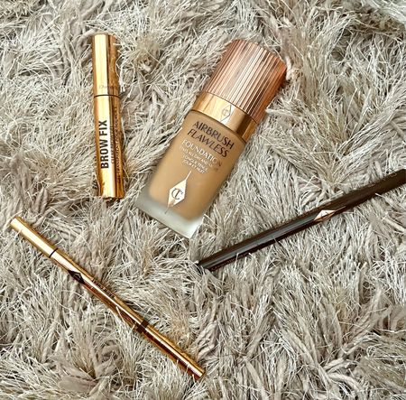 Here are my current faves from Charlotte Tilbury! I've been loving their airbrush flawless foundation, brow pencils and brow gel (helps your brows last 24hrs 🙌🏽)  #LTKunder100 #LTKunder50 #LTKbeauty