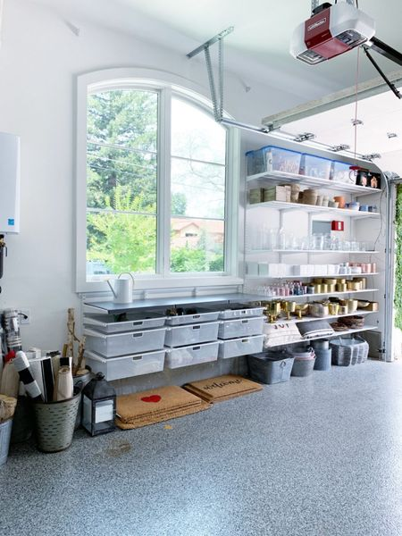 This Elfa garage system created the ultimate garage workspace for this sweet and very talented florist. || #elfa #elfasystems #containerstore #garage #garageshop #garageworkspace #garageorganization #organization #storage #workshop  #LTKhome