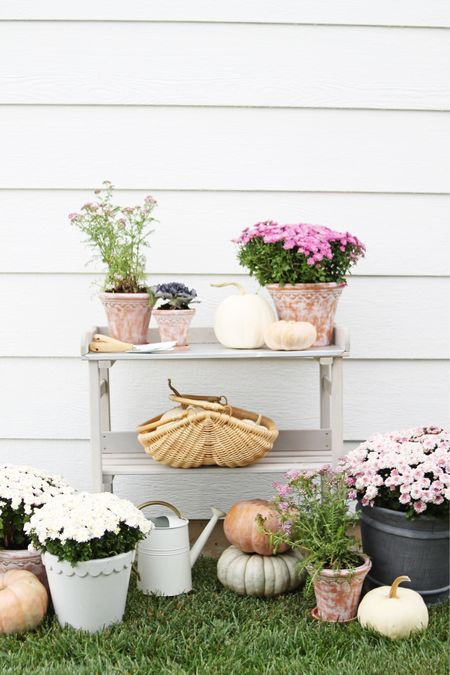 Outdoor fall decor doesn't just have to be for the porch! A potting bench is a great way to make your decor both functional and beautiful! I used it to fill pots with fall plants like mine, yarrow and cabbage, which do look beautiful on our porch but also dress up the potting bench in a unique way. See more photos and get more outdoor fall decor tips today at courtneymbrowning.com!  . .   #LTKhome