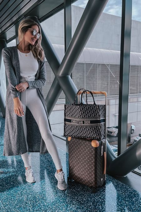 Airport outfit idea , elegant outfit inspiration, white loungewear set , comfy sneakers, comfy adidas , grey maxi cardigan, Comfy and elegant outfit,  casual and chic style, tote bag    #LTKtravel #LTKshoecrush #LTKstyletip