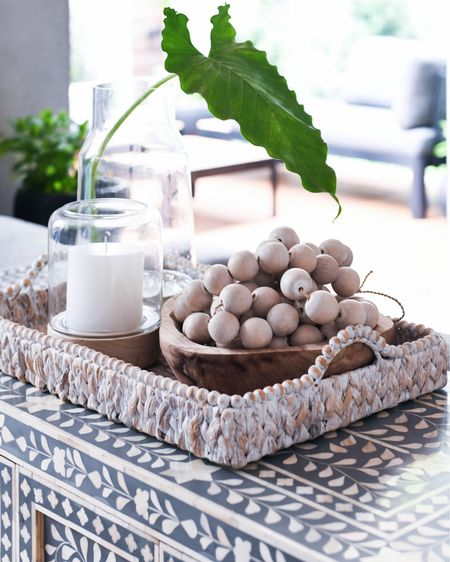 Do you love simple vignette styling as much as I do? Grab a simple stem, add to a vase then layer onto a textured tray with a beautiful candle and 👌🏼. #tray #vignette #boneinlay #hurricane #candles  Shop your screenshot of this pic with the LIKEtoKNOW.it shopping app http://liketk.it/35614 #LTKstyletip #LTKunder100 #StayHomeWithLTK @liketoknow.it.home @liketoknow.it.family #liketkit @liketoknow.it