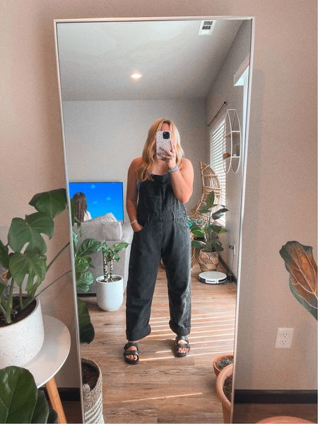 Oversized overalls I'm 5'1 wearing the size medium, I typically wear an 8 in jeans. Paired with a perfect pop of color crop tank Free people Black denim Fall transition styles Bracelet stack    #LTKstyletip #LTKSeasonal #LTKunder100