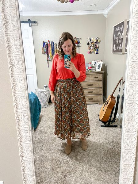Love this floral midi skirt. It's has so many colors in it! You can wear it with a lot! It comes in sizes small to xxl!   #LTKcurves #LTKbacktoschool #LTKSeasonal