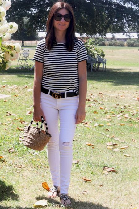 Love this black and white horizontal stripe t-shirt! It goes with everything!! I can't get enough of these white distressed AG skinny jeans!! They are a classic staple and really elongate the leg. Must have straw bag, Gucci cat eye sunglasses, Tory Burch Miller sandals! Summer outfit. Summer style. Memorial Day weekend outfit.   #LTKshoecrush #LTKstyletip #LTKSeasonal