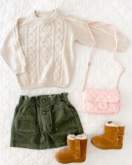 The perfect fall outfit for baby or toddler girls! Baby Ugg's toddler girl outfit girl outfit baby girl outfit Chanel purse look alike pink purse girl purse corduroy skirt toddler sweater family pictures Amazon find toddler handbag toddler purse little girl purse #ltkitbag ugg boots cable knit sweater family photo family photo outfit little girl outfit cream sweater   #LTKbaby #LTKhome #LTKbeauty