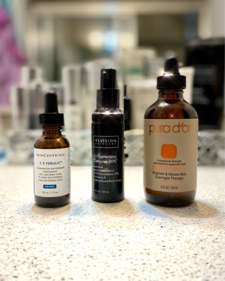 """A vanity of Vitamin 🍊 C  • The top two primo Vitamin C serums for your face and the """"dupe"""" for the rest of your body. • Skinceuticals C E FERULIC is the most notorious Vitamin C serum and has been for over a decade. It improves the appearance of fine lines and wrinkles and is an antioxidant powerhouse. This is a liquid consistency and dispensed with a dropper. • Second to none is the Revision Skincare C+ Correcting Complex. A concentrated and potent blend of antioxidants that brightens and firms skin. This has more of a lotion consistency and I like to alternate bottles between this and the Skinceuticals C E. • And the economy sized """"dupe"""" that I use as a serum for the rest of my body (think chest, arms, etc.) is this organic blend, 20% concentrate from PURA D'OR that's only $15 on Amazon. • Vitamin C is best applied in the morning, after toning and before moisturizing. Anyone can benefit from using a Vitamin C serum no matter their age and should definitely be part of a healthy skincare routine.   http://liketk.it/35J41 #liketkit @liketoknow.it #LTKbeauty #vitaminc #skincare #antiaging #botox #beauty"""