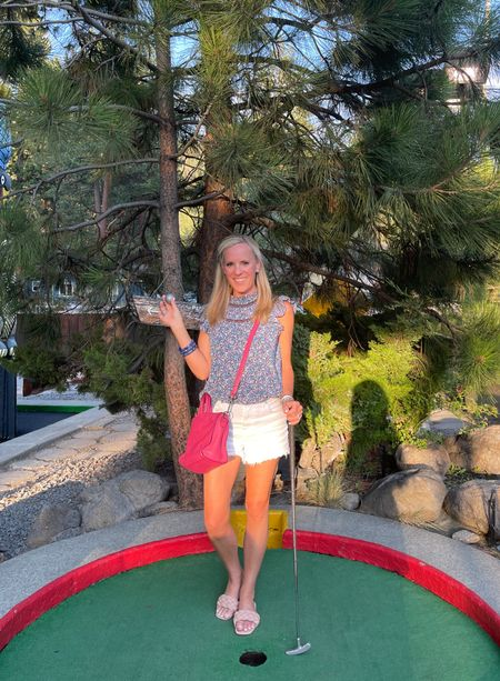 Lady Luck was on my side! I got my first hole in one! We have a tradition of playing putt putt in King's Beach every time we come. The courses are fun and challenging! Best family night!  Get the details on my darling dark floral top, best whitening shorts and these braided sandals on the link in profile and when you follow me in the @shopltk app  This dark floral top features lavender and blue flowers on a navy background with ruffle sleeves and lace detailing. I'm wearing a small. Best white denim shorts that aren't too short! Also love these braided nude slides. They are so comfortable! Fit TTS   #LTKshoecrush #LTKunder100 #LTKtravel