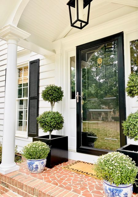 Front door styling, traditional fall decor, blue and white planter, topiary, brass lion door knocker, bamboo shade   #LTKSeasonal #LTKunder100 #LTKhome