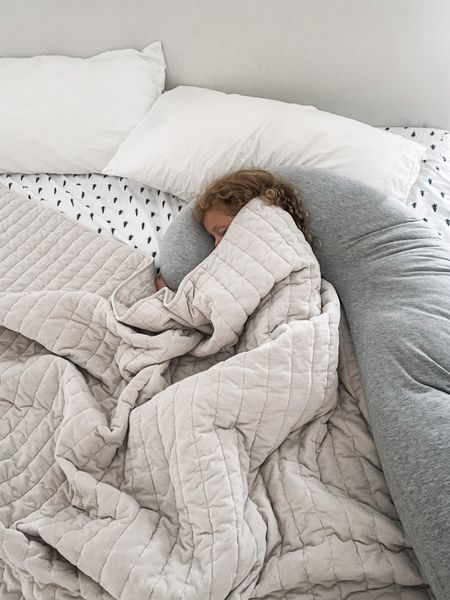 Naps are best in mama's bed and with the pregnancy pillow 😍 yes, those are my Christmas sheets (summer sheets in the wash!).  #sheets #pillow #pregnancypillow #comforter #bedding #masterbed #masterbedroom #potterybarn #pillows #neutrals   #LTKunder50 #LTKhome